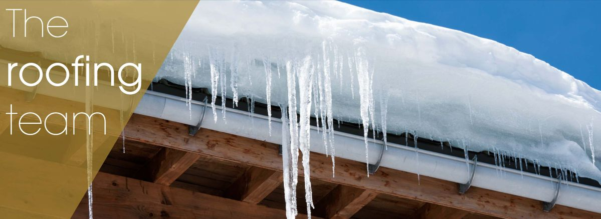 The-roofing-team-–-House-with-a-snow-filled-roof